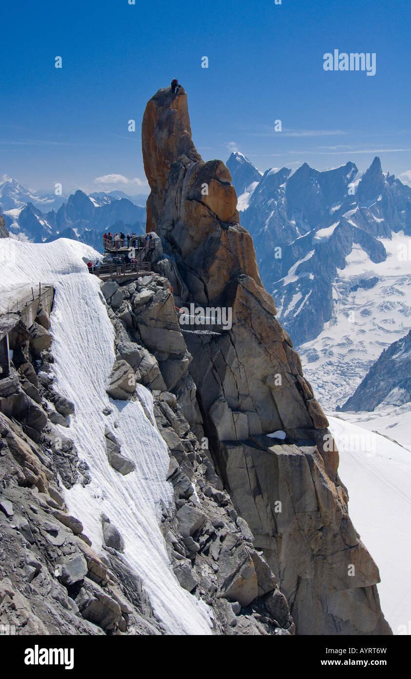 Mountain climber standing on a rock platform, Mt. Aiguille du Midi, Mont Blanc Massif, Chamonix, France Stock Photo