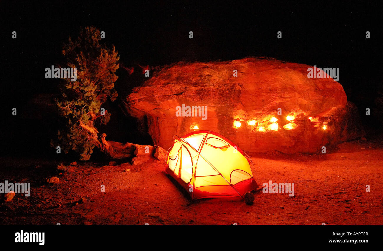 Illuminated tent at a campsite, nighttime, Canyonlands National Park, Utah, USA - Stock Image