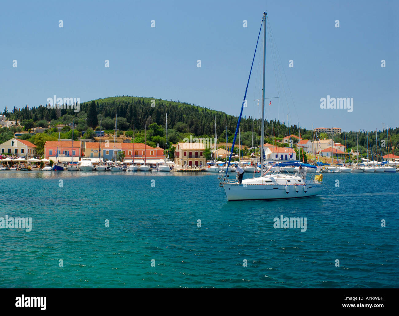 Sailboat in the harbour of Fiscardo, Kefalonia, Ionian Islands, Greece - Stock Image