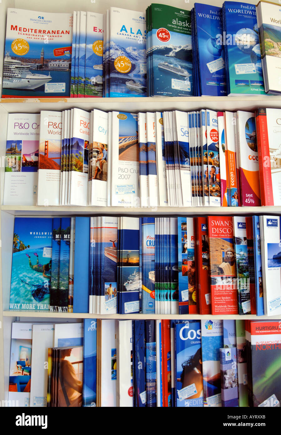 Travel brochures on display at travel agency, Britain UK