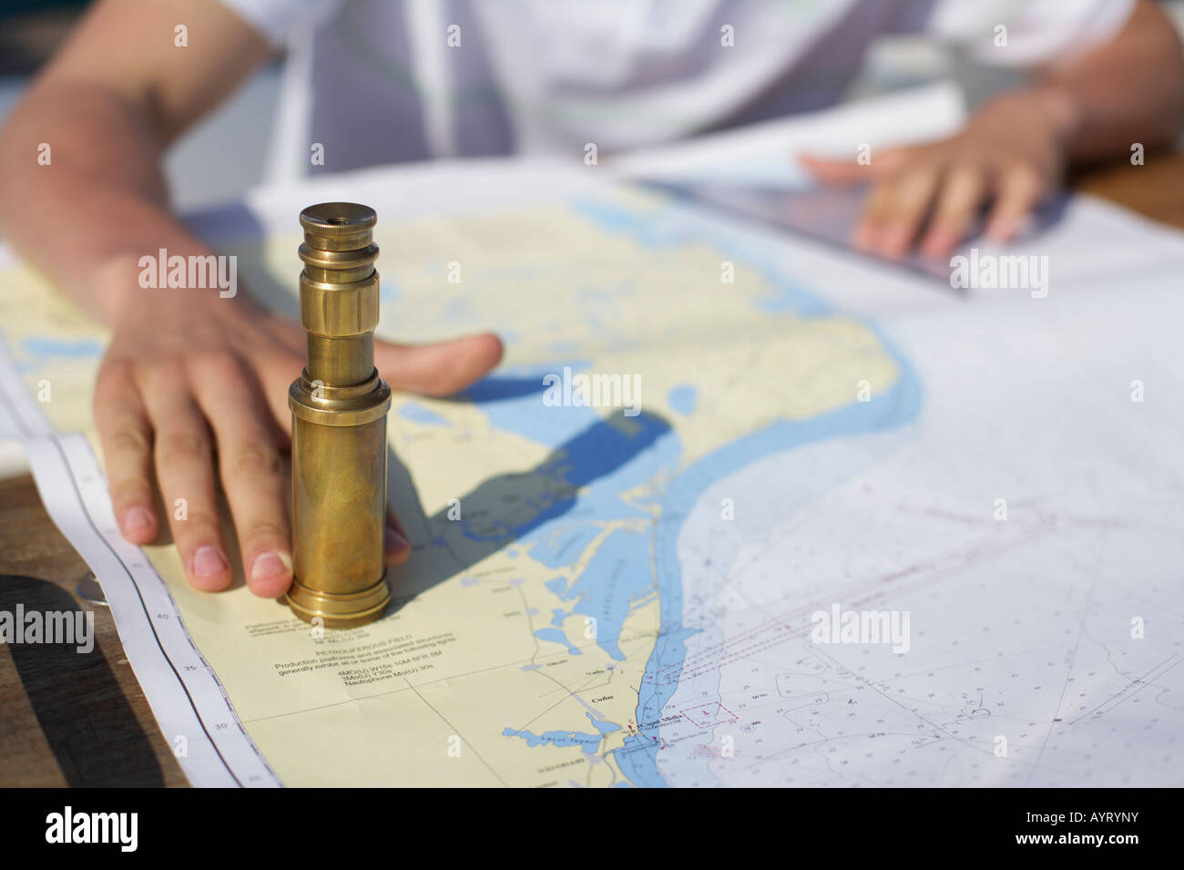 Long glass on a sea chart - Stock Image