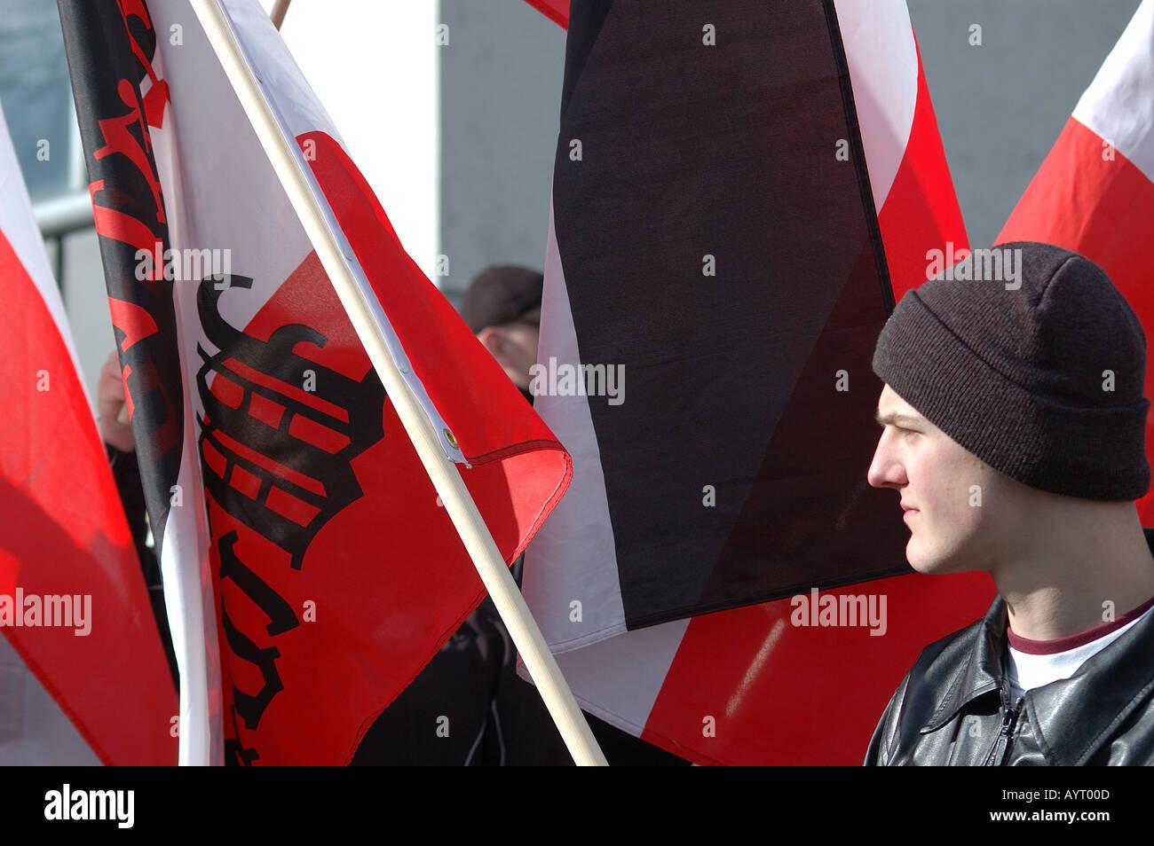 German far right demonstrator amid flags Dresden - Stock Image
