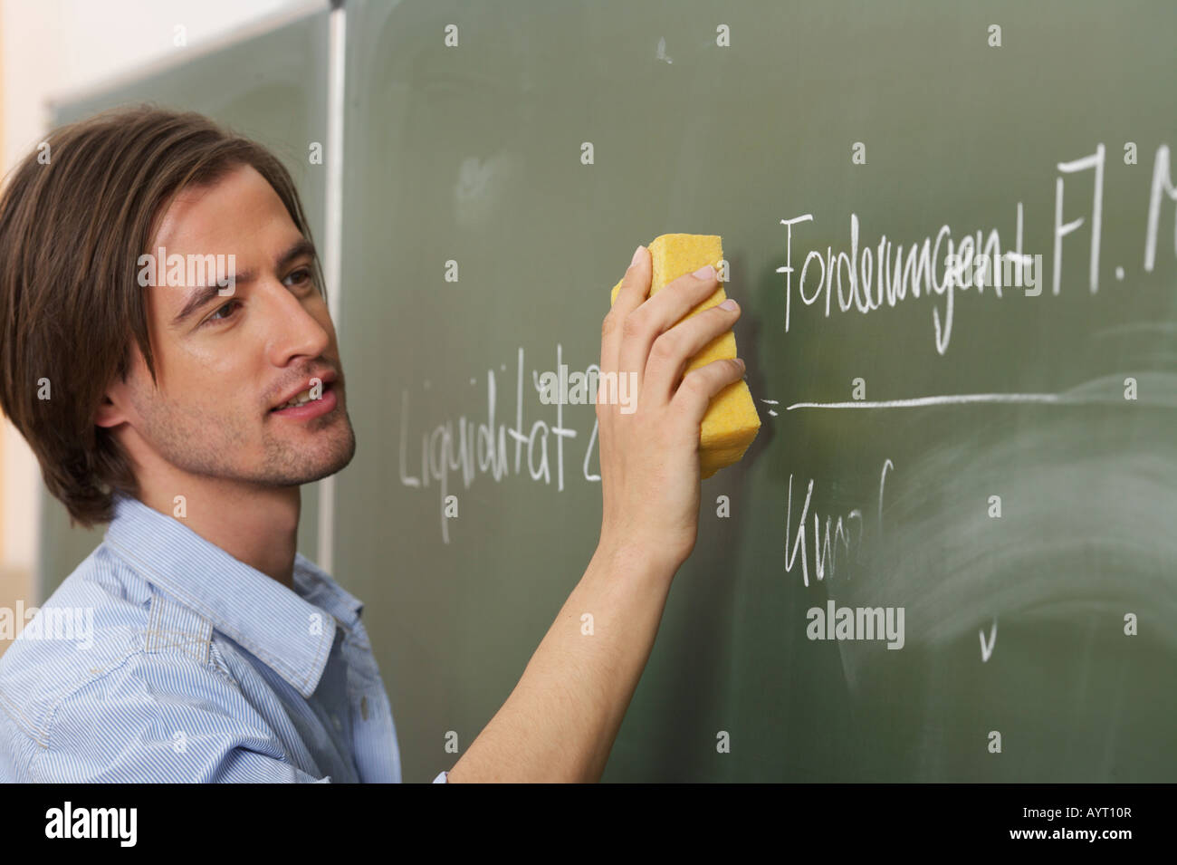 A man is smearing the board - Stock Image