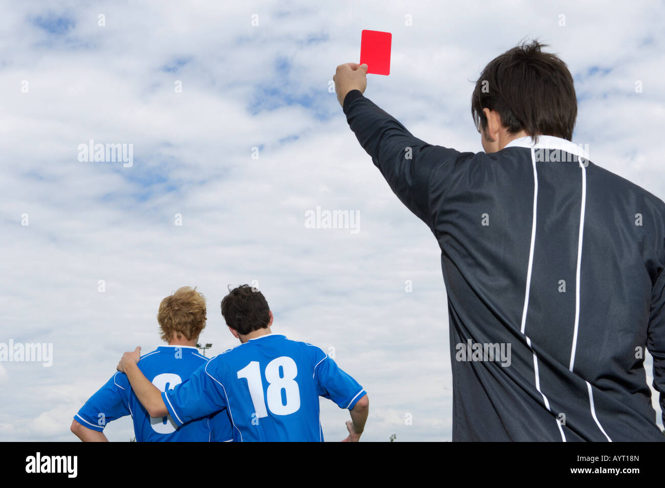 Referee showing red card to kicker - Stock Image