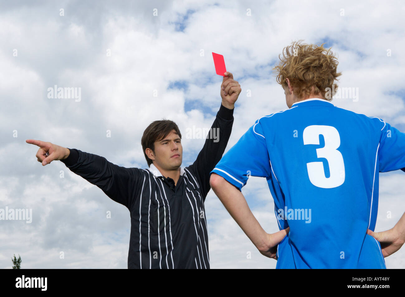 Referee showing red card - Stock Image