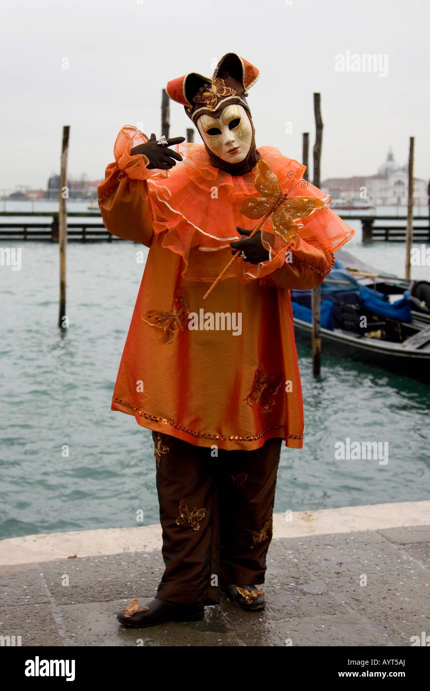 Golden harlequin (court jester) costume and mask in front of gondolas Carnevale di Venezia Carneval in Venice Italy  sc 1 st  Alamy : harlequin jester costume  - Germanpascual.Com