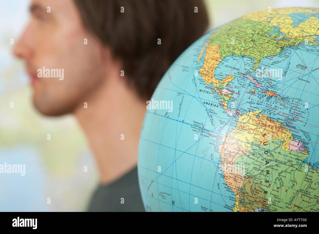 A Man beside a globe - Stock Image