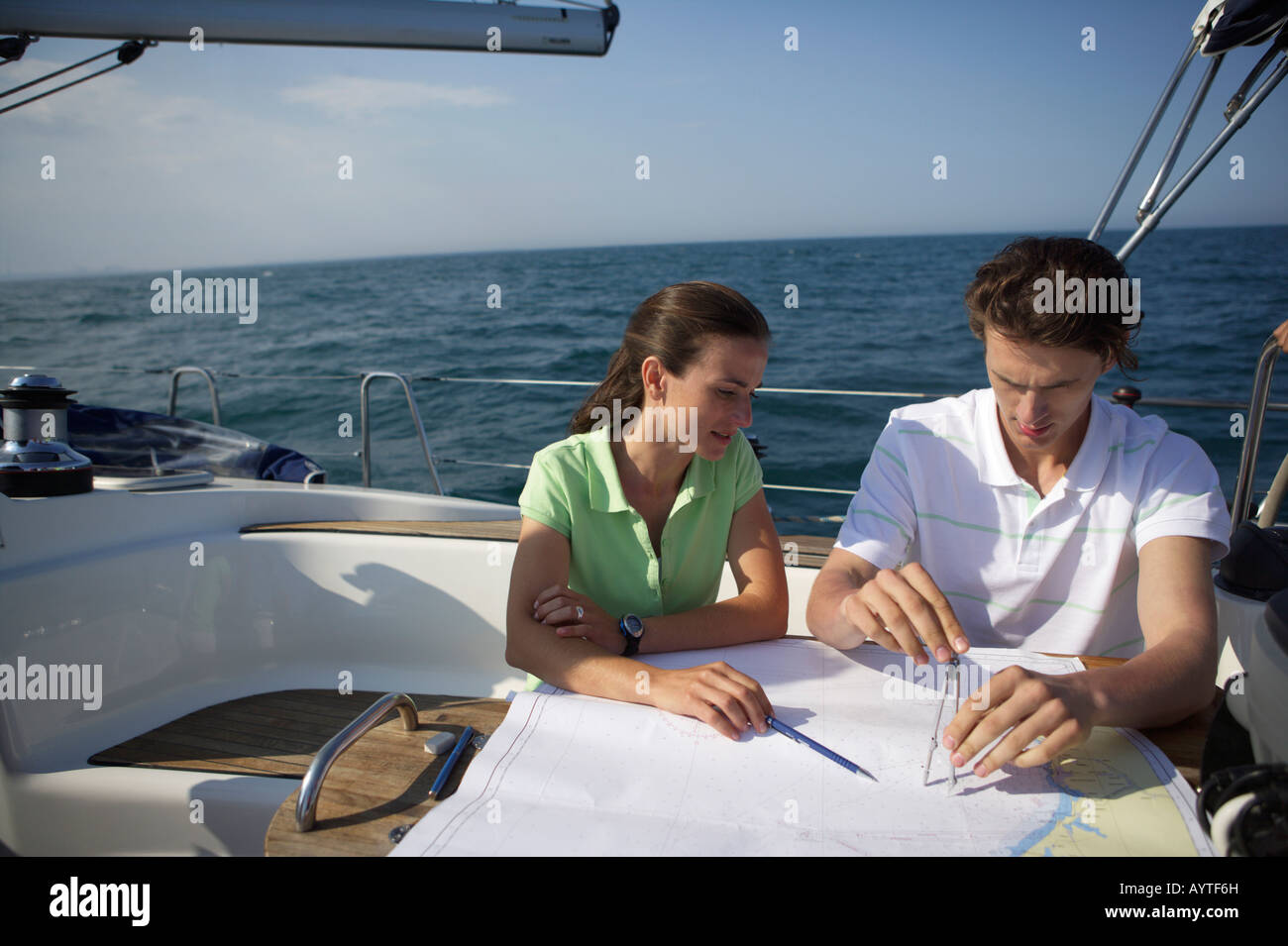 Two people working on a sea chart - Stock Image