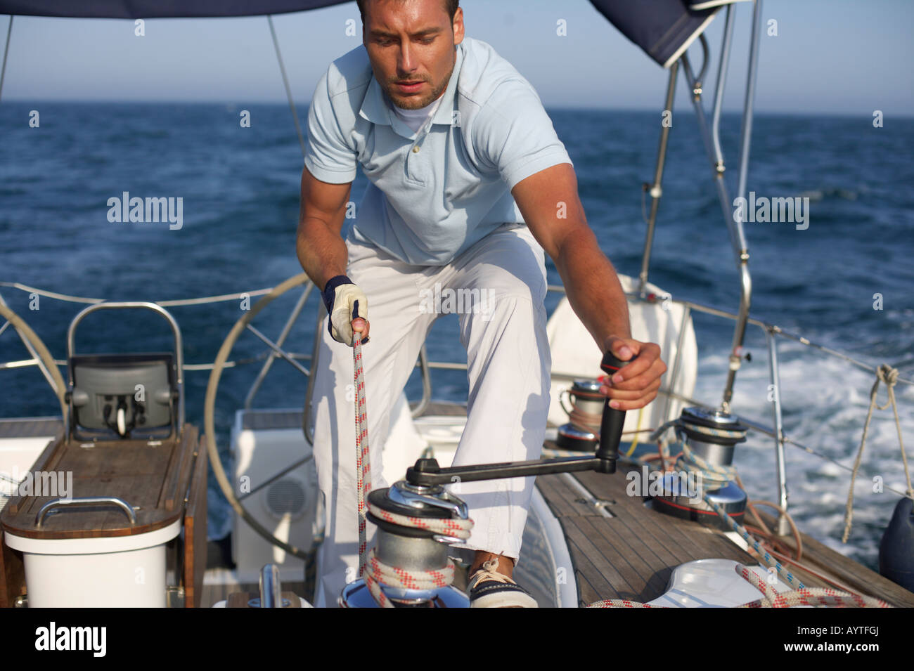 Man working on a yacht, truncated Stock Photo