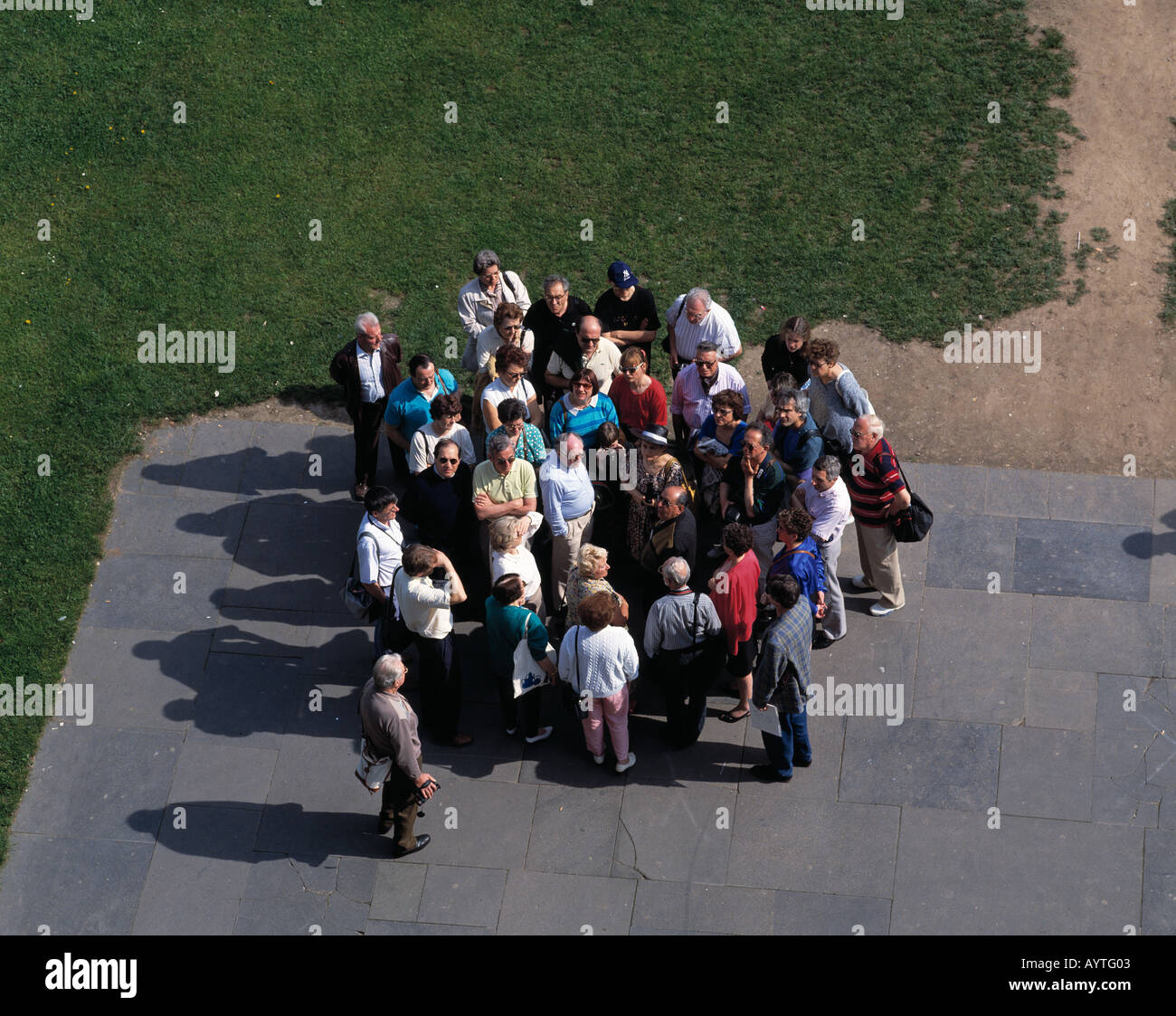 tourists group, group of tourists, tourist guide, guided tour - Stock Image