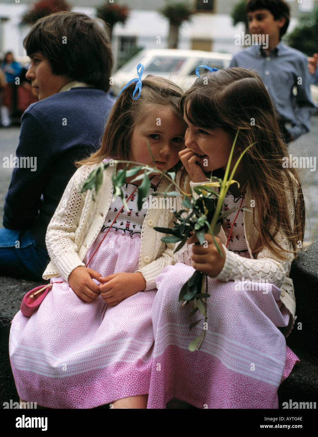 Spain, Tenerife, Canary Islands, E-La Orotava, young girls with palm fronds, Palm Sunday Stock Photo