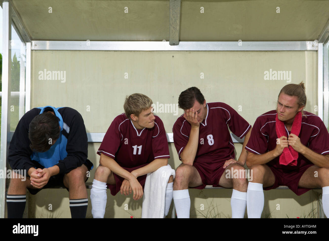 Disappointed kickers sitting on substitutes' bench - Stock Image