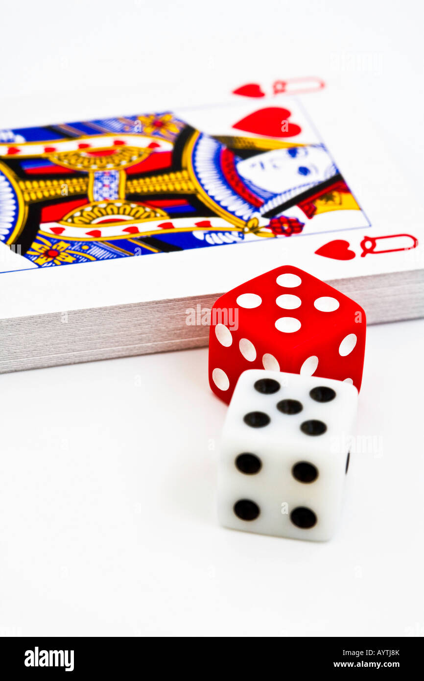 Queen of hearts playing card and dice one white one red on a white background - Stock Image