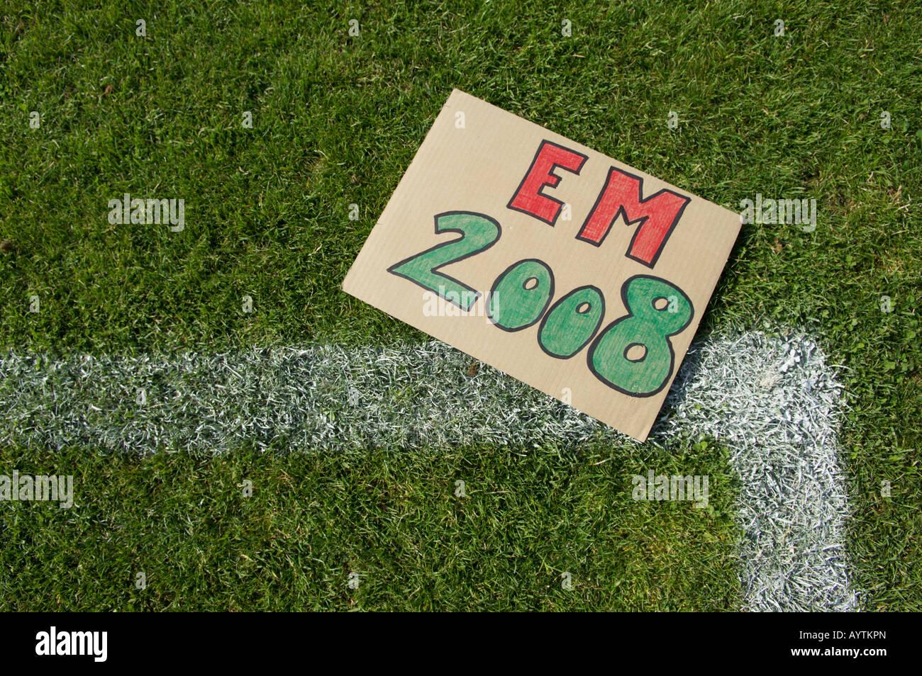 EM 2008 sign lying on soccer field - Stock Image