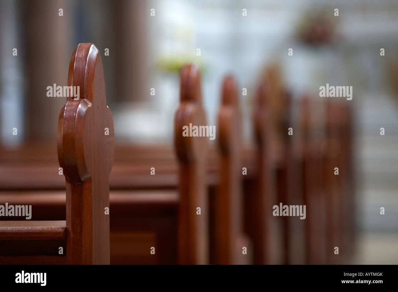 row of wooden pews in a church Stock Photo