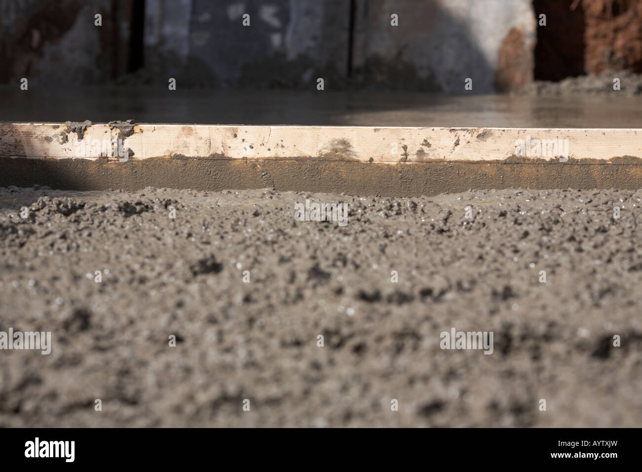 piece of wood used to level off concrete whilst laying concrete base Stock Photo