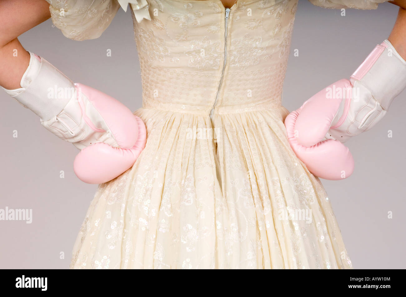 A bride wears pink boxing gloves in a light-hearted look at prenuptial agreements and getting married. Picture by Jim Holden. Stock Photo