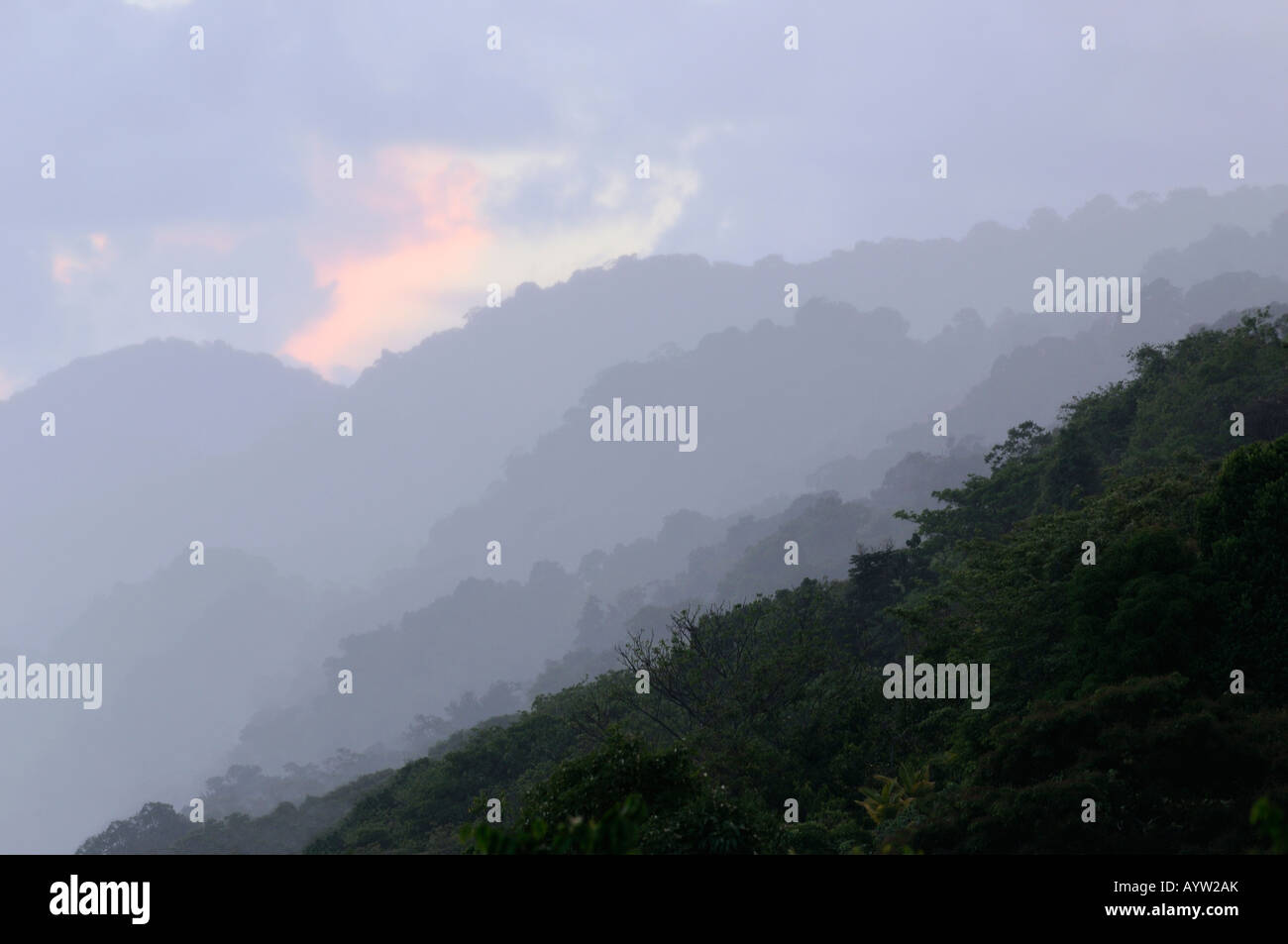 Receding steamy hills on the Osa Peninsula coast at dusk in Costa Rica - Stock Image