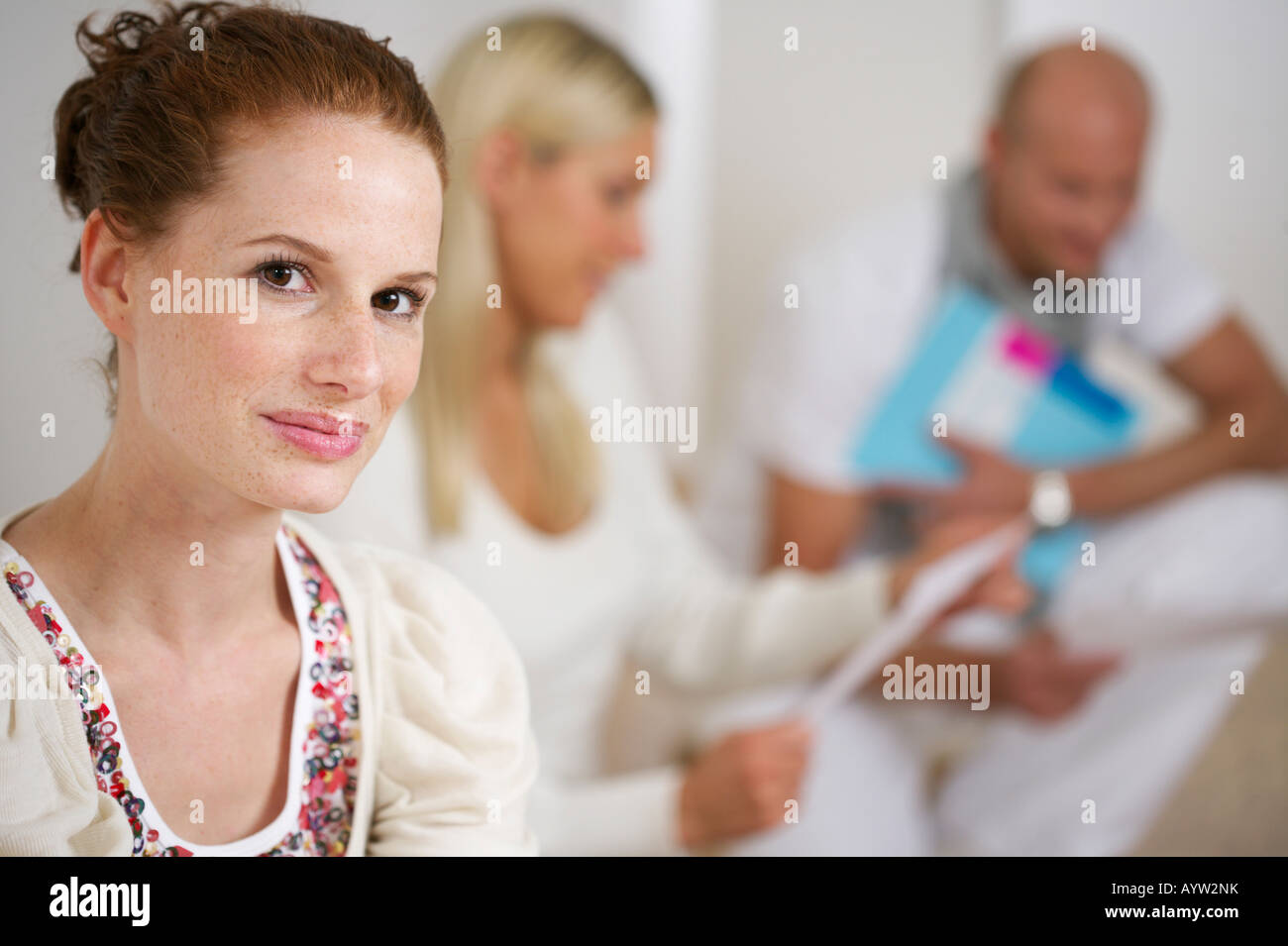 Young woman smiling at camera - Stock Image