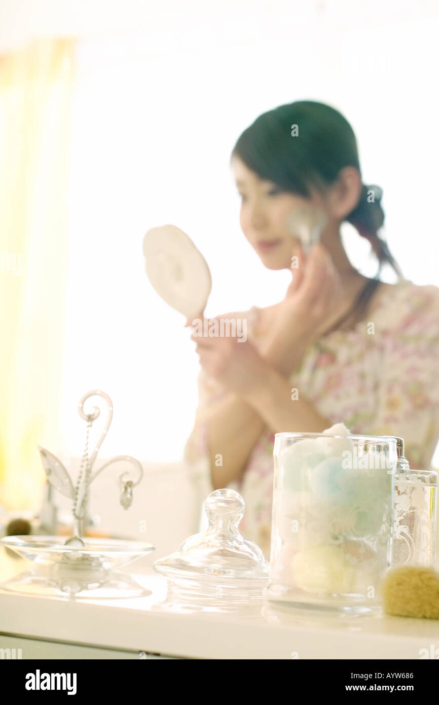 Woman making up in the dressing room - Stock Image