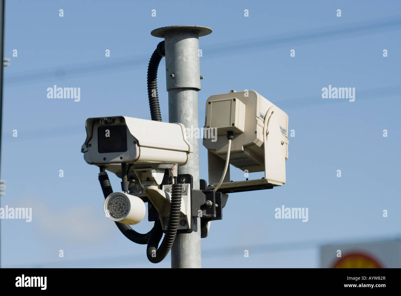 Closed circuit television cameras watch over at a car park at Toddington service station - Stock Image