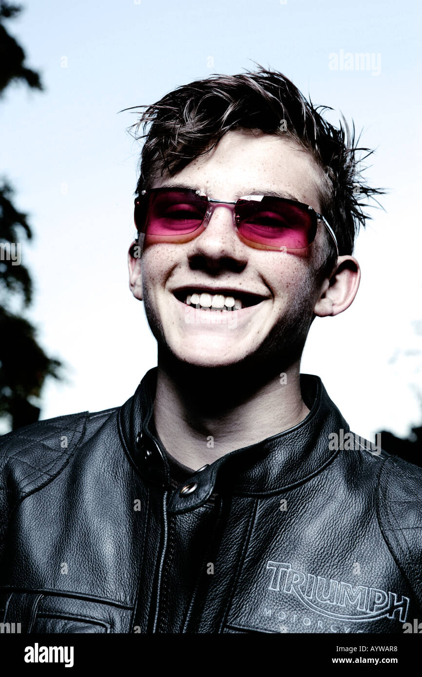 Laughing rockerbilly with pink tinted shades - Stock Image