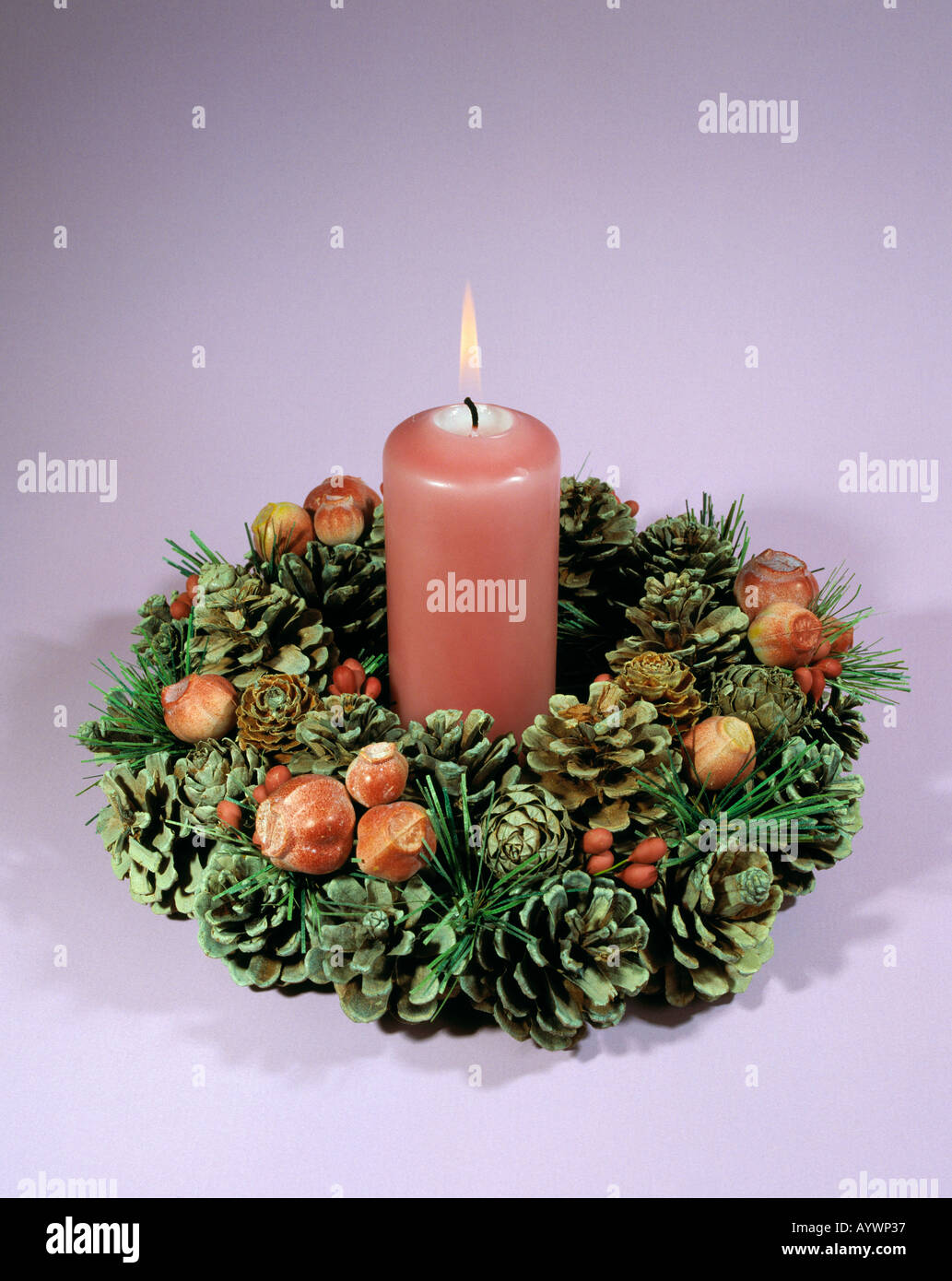 Christmas, Christmas period, run-up to Christmas, pre-Christmas, Advent wreath, flower arrangement, burning candle, pink - Stock Image