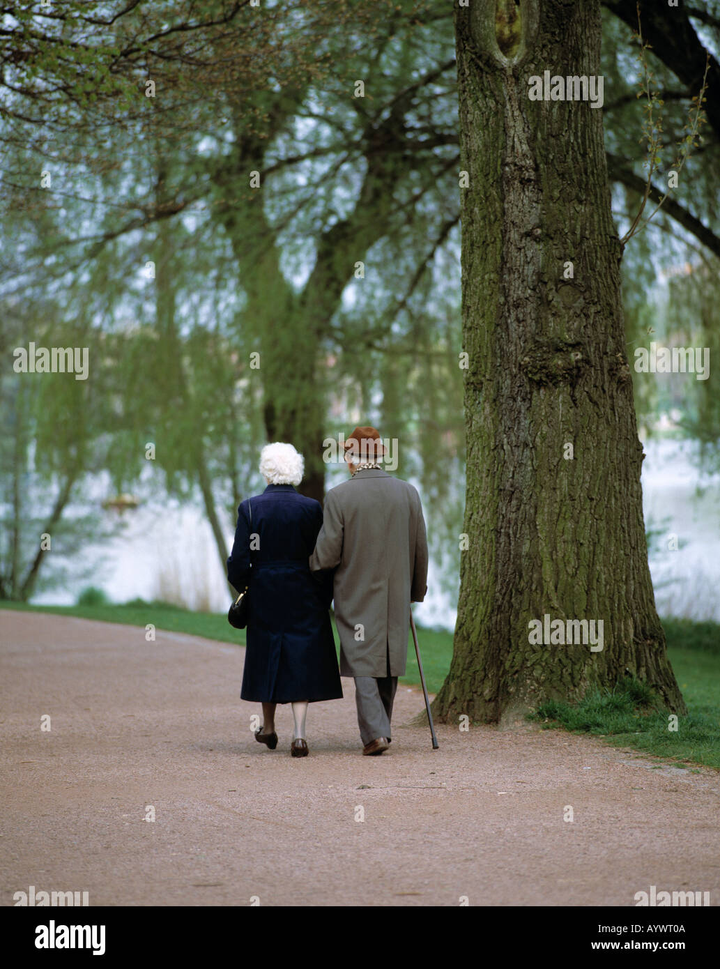 old couple, married couple, walking in a park Stock Photo