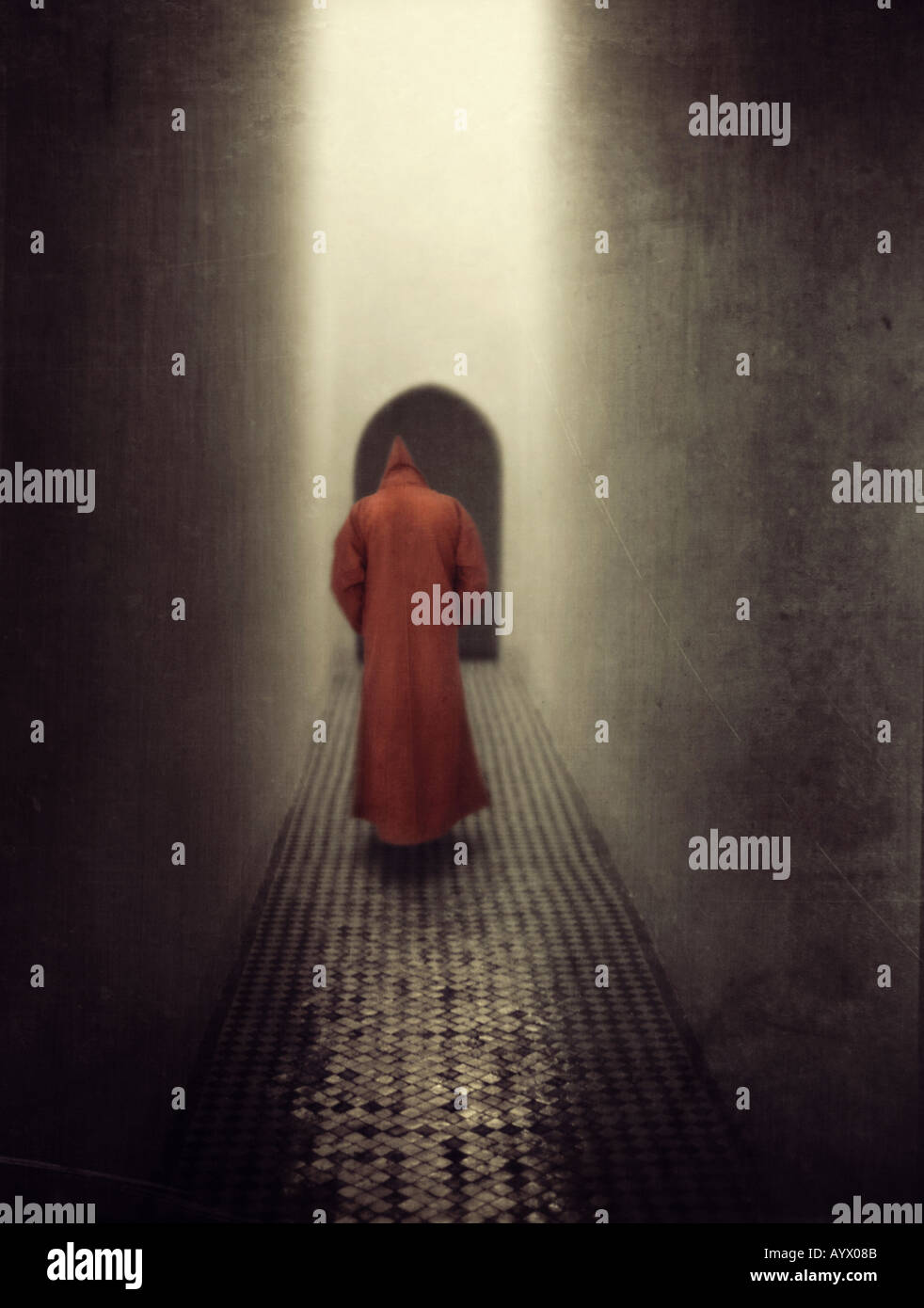 monk floating in air in monastery hallway Stock Photo