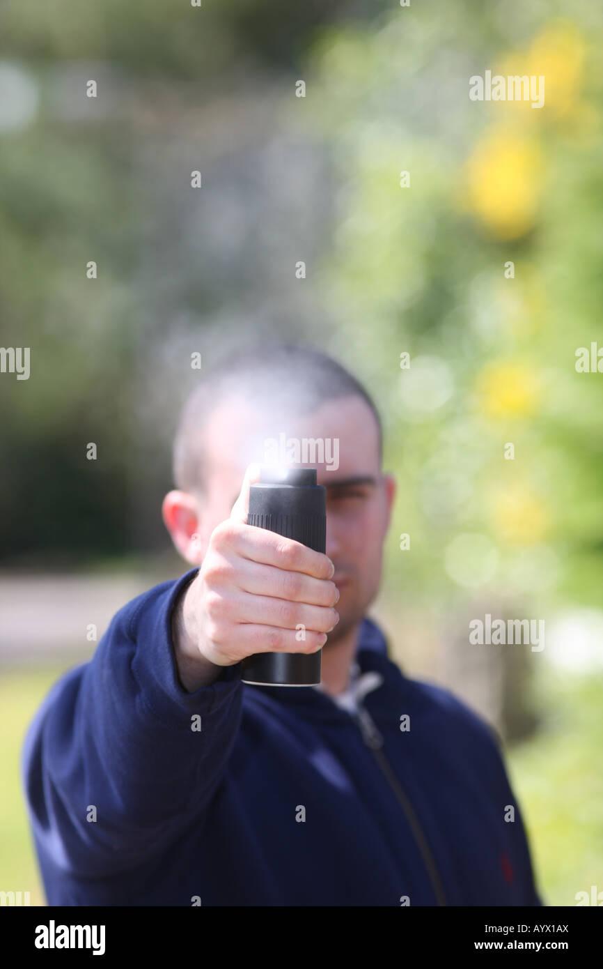 Man Spraying CS Spray - Stock Image