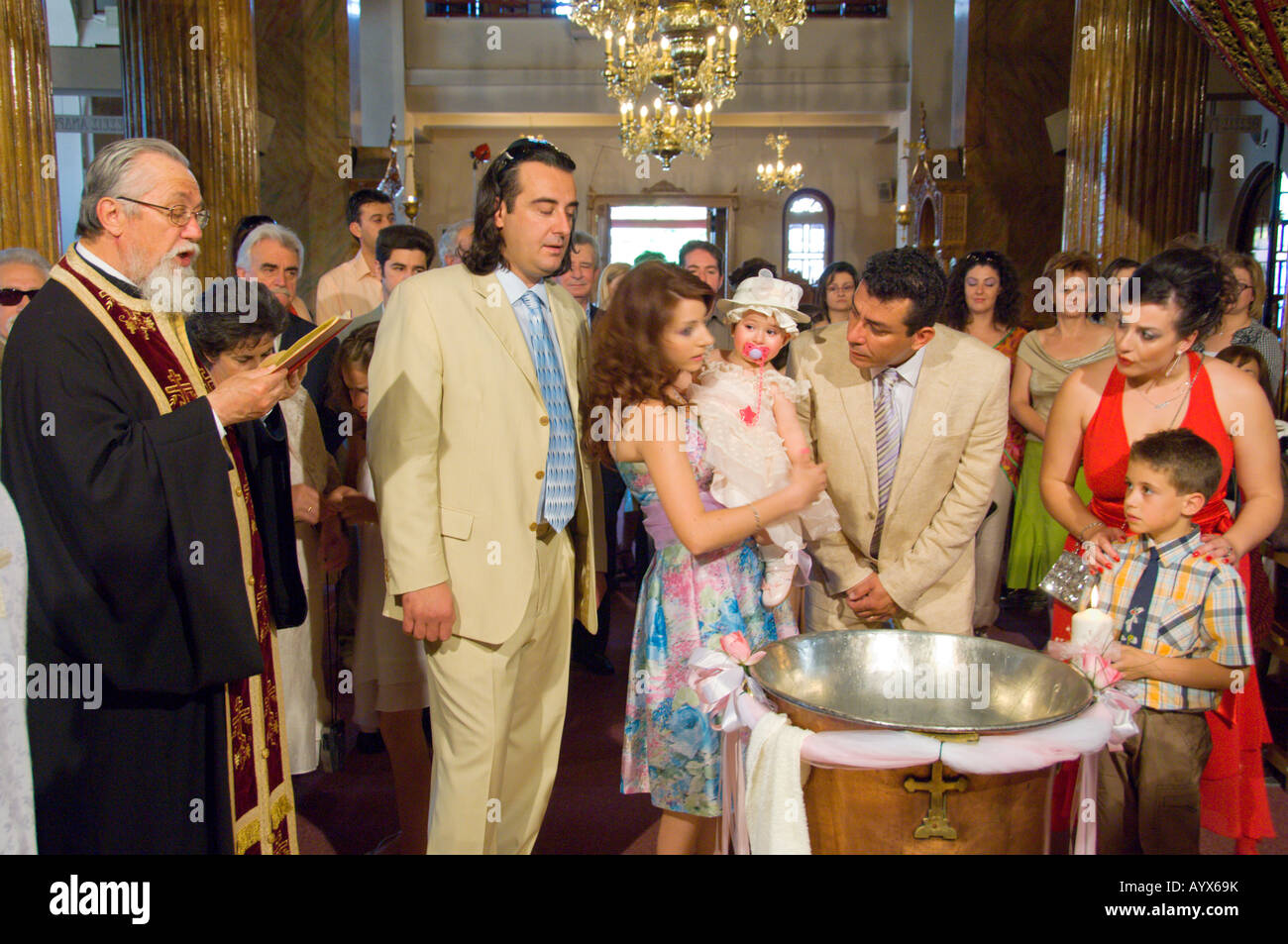 Infant baptism or Christening in a Greek Orthodox Church in Trikala Greece - Stock Image
