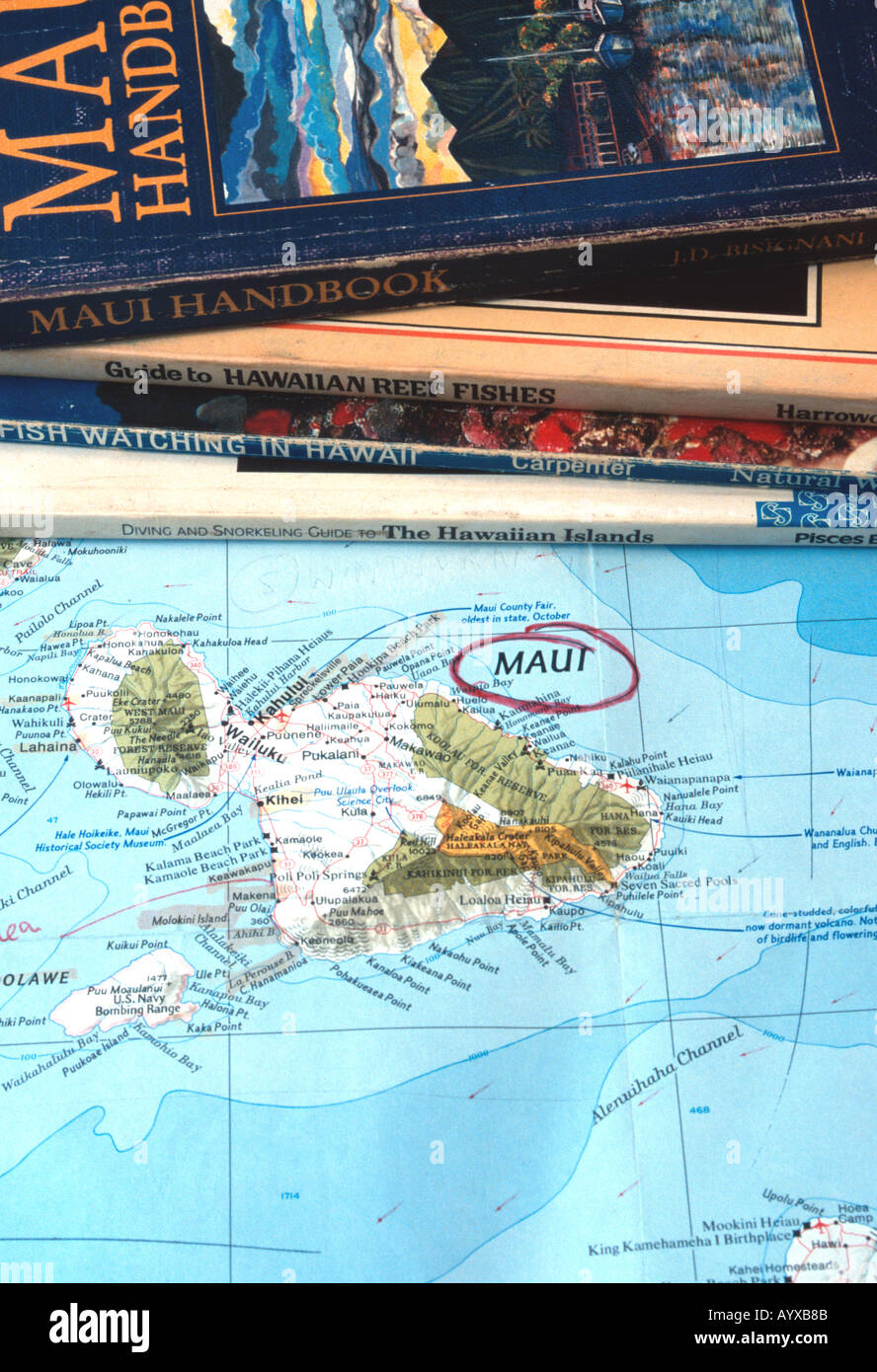 Maui Handbook and other guidebooks on map
