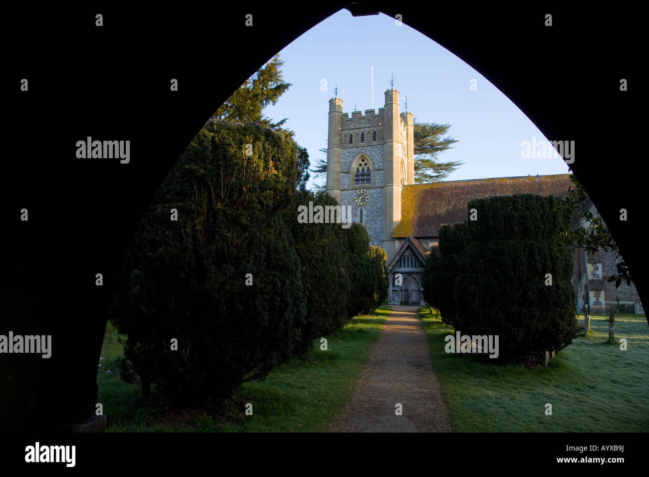A footpath to Hambleden parish church from the lych gate Bucks UK - Stock Image