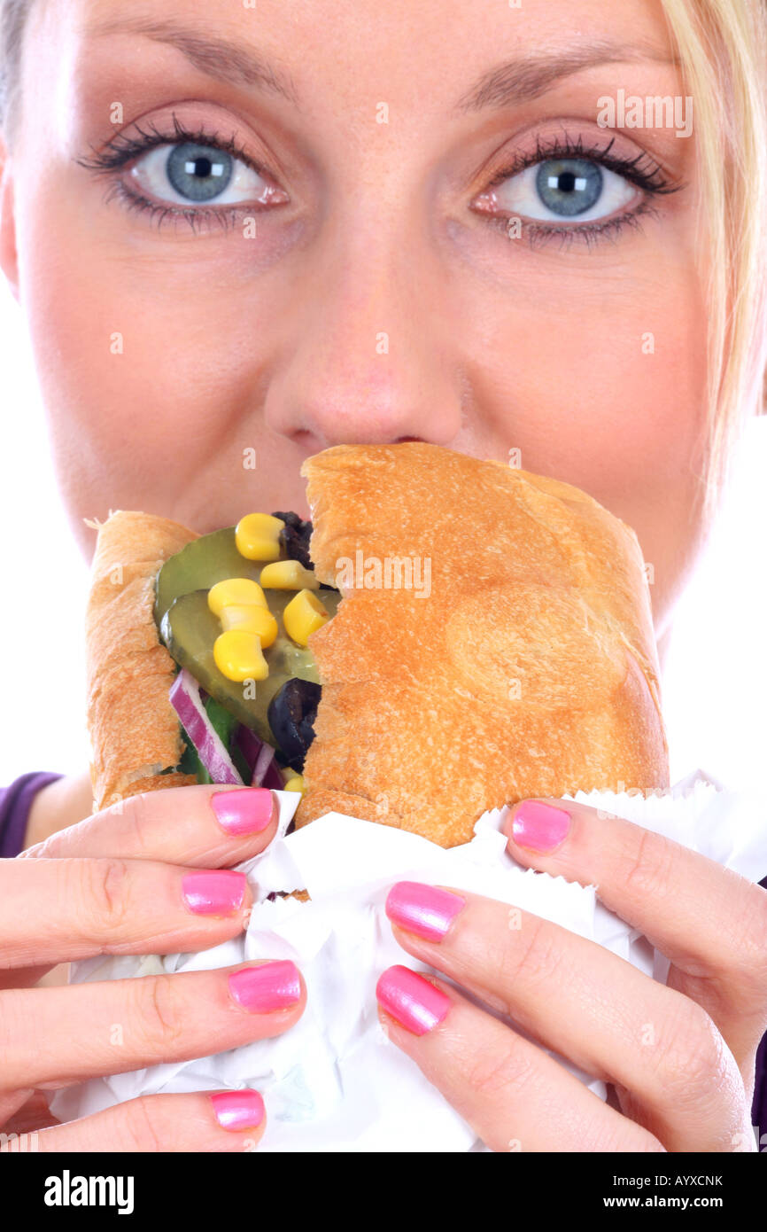 Young Woman Eating Vegetable Sandwich Model Released - Stock Image