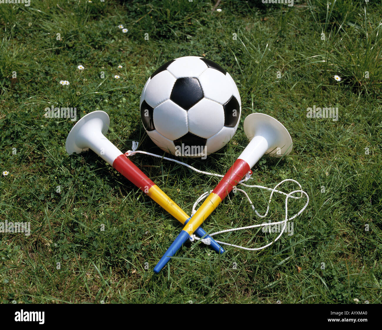 sports, football, ball with two trumpets, symbolic photograph Stock Photo