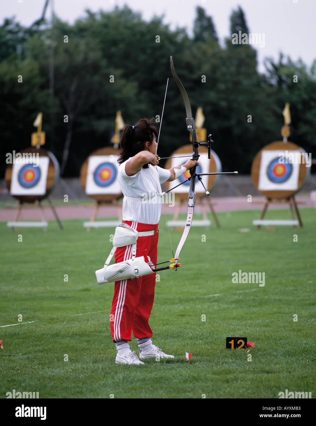 sports, archery, women, woman, marksman, marksmen, shot, shoot, target Stock Photo