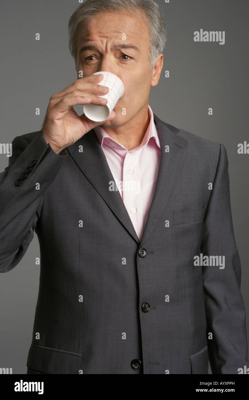 Businessman drinking a cup of water Stock Photo