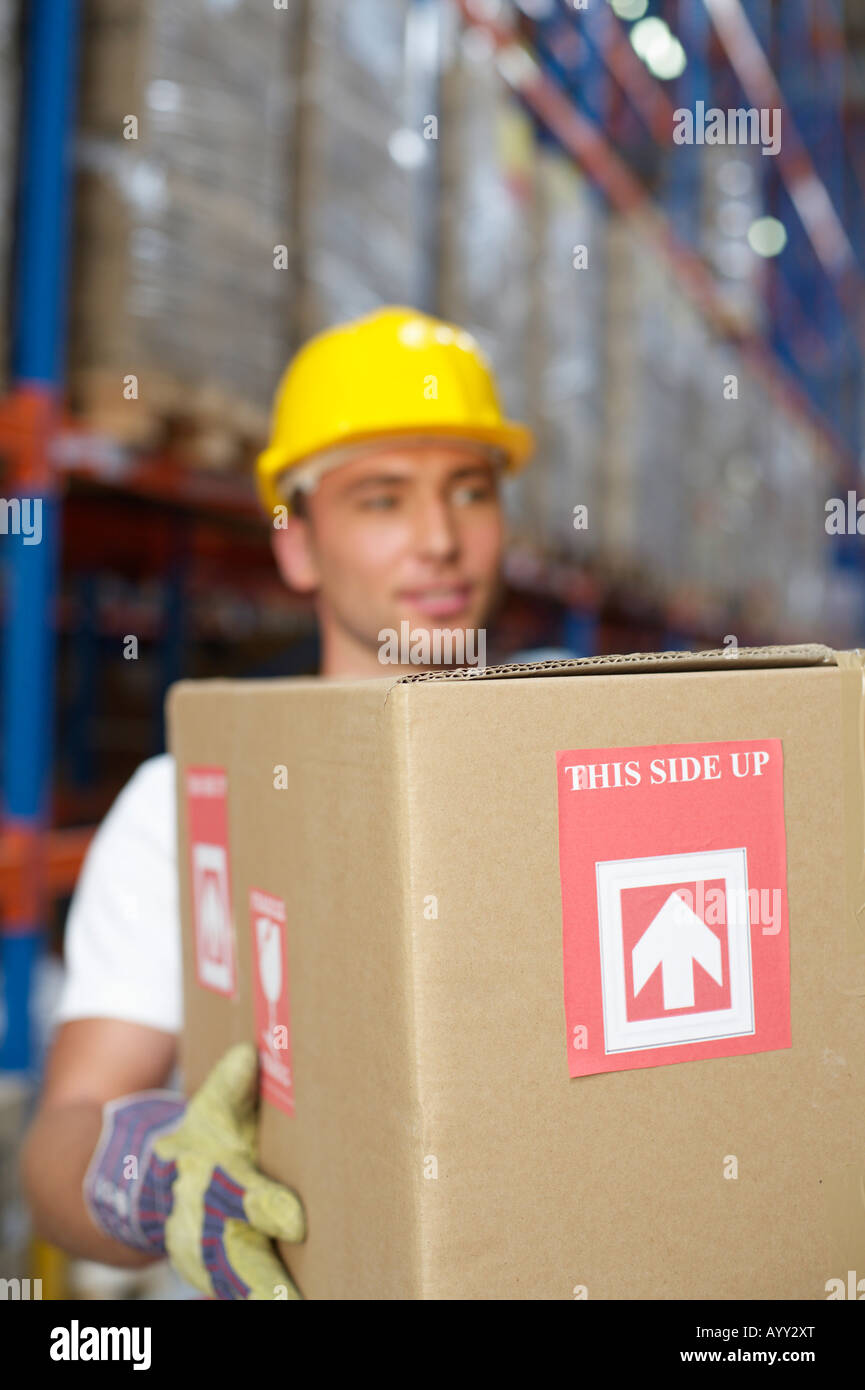 Man carrying a packet - Stock Image