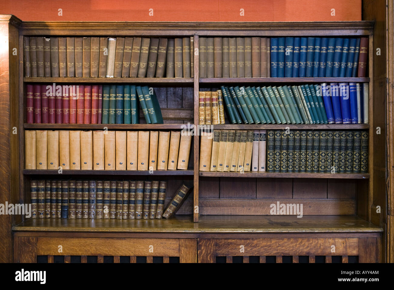book shelves with old leather bound books - Stock Image