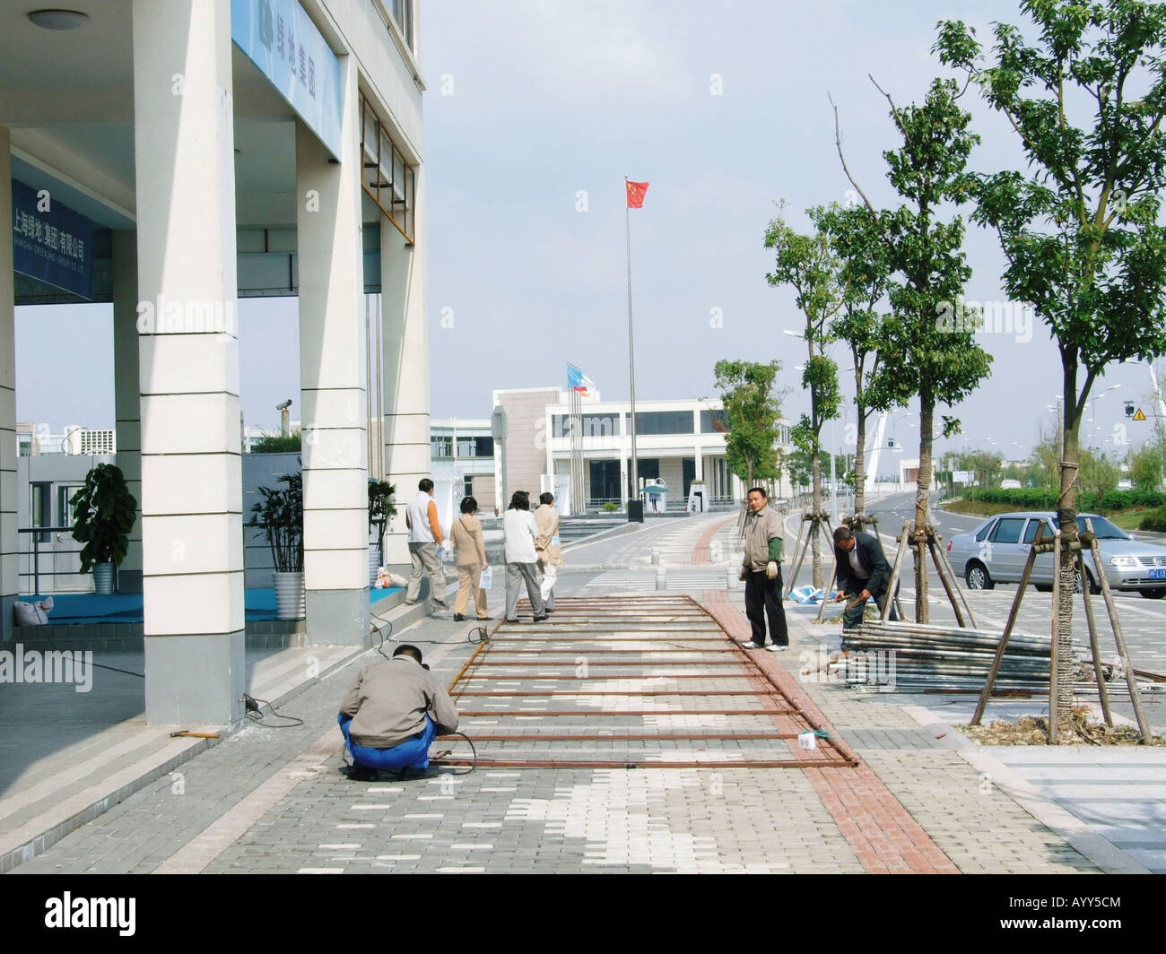 Construction workers in Lingang New City near Shanghai China Stock Photo