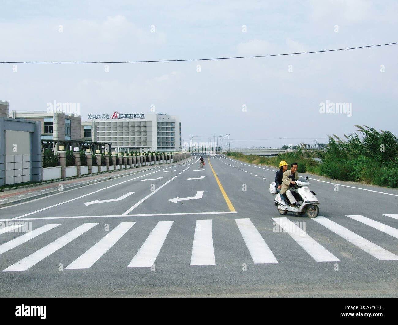 People on a new built road in Lingang New City near Shanghai China Stock Photo