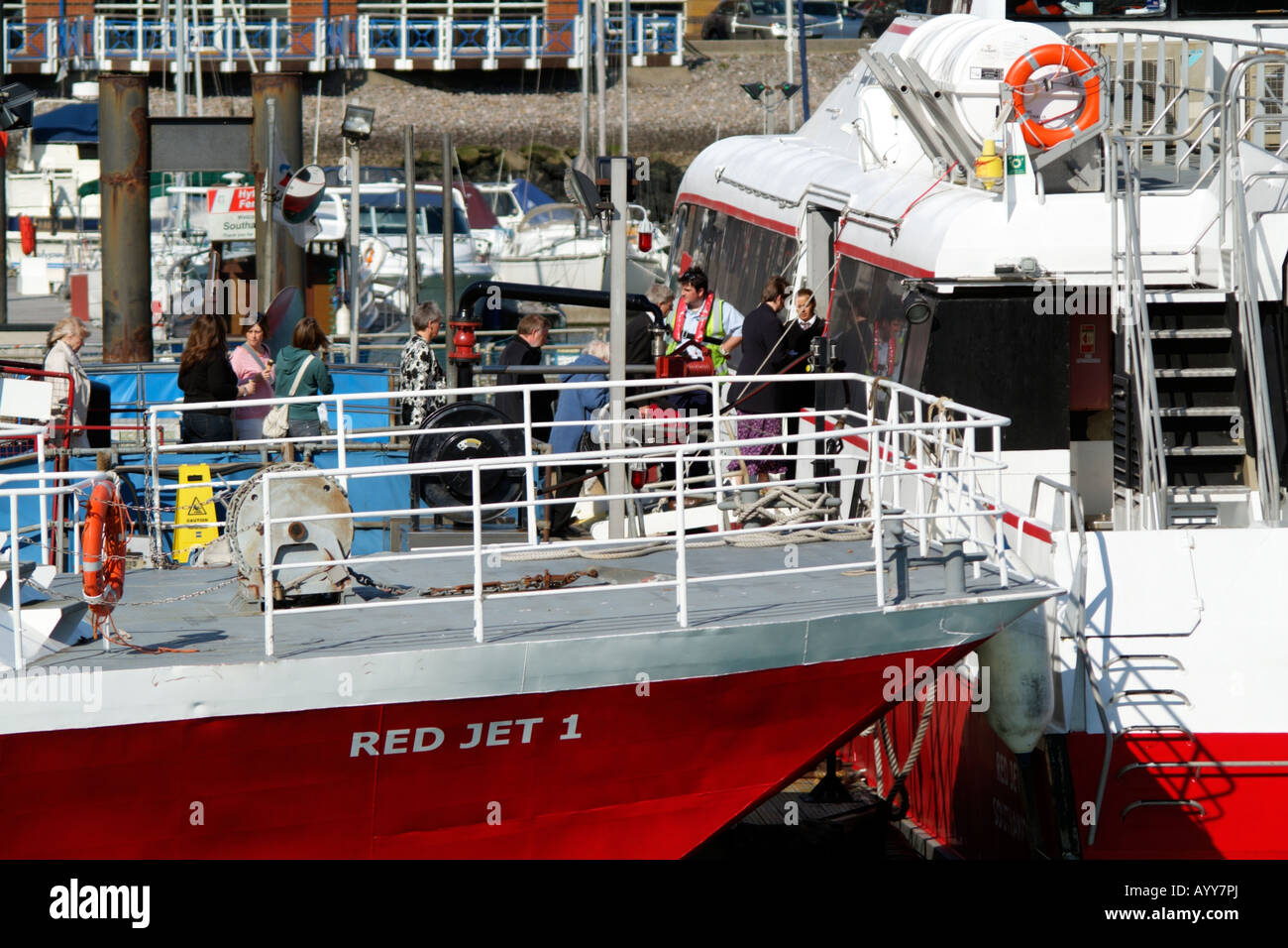 red funnel ferry company red jet hi speed service catamaran foot passengers boarding vessel fleet town quay southampton - Stock Image