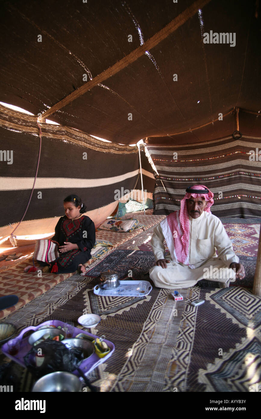 A Bedouin man and his daughter in their tent The Bedouins have lived for thousands of years in the desert around - Stock Image