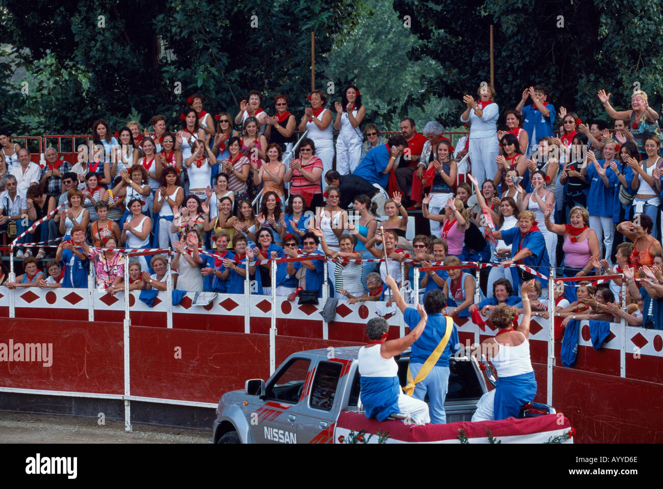 Female spectators gather and sing before a bullfight on the Fiesta of Womens Day in the bull fighting ring of Autol - Stock Image