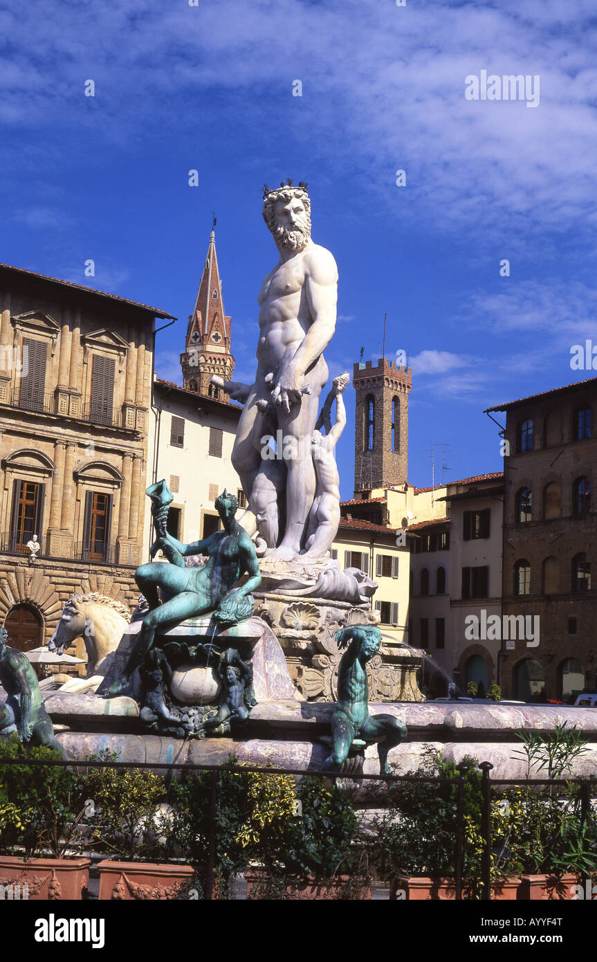 Ammaniati's Neptune Fountain Piazza della Signoria Badia Fiorentina and Bargello towers in background Florence Tuscany Stock Photo