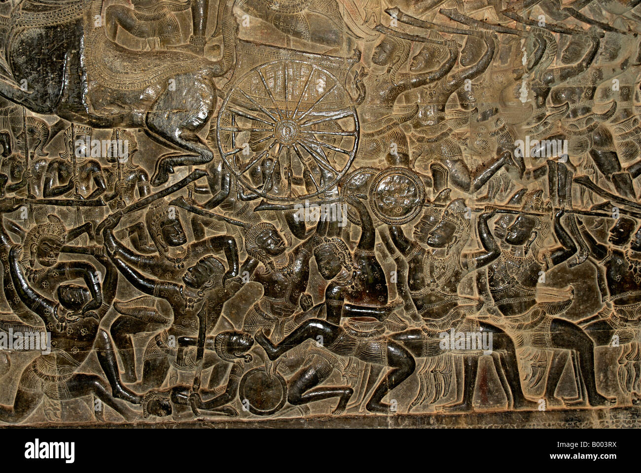 Cambodia, Angkor Wat, early 12th century. Battle scene on chariot upper level Eastern Outer Gallery. - Stock Image