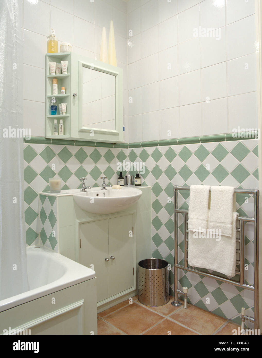 Green And White Tiles Below Dado In Modern White Bathroom With Built In  Basin And Chrome Towel Rail
