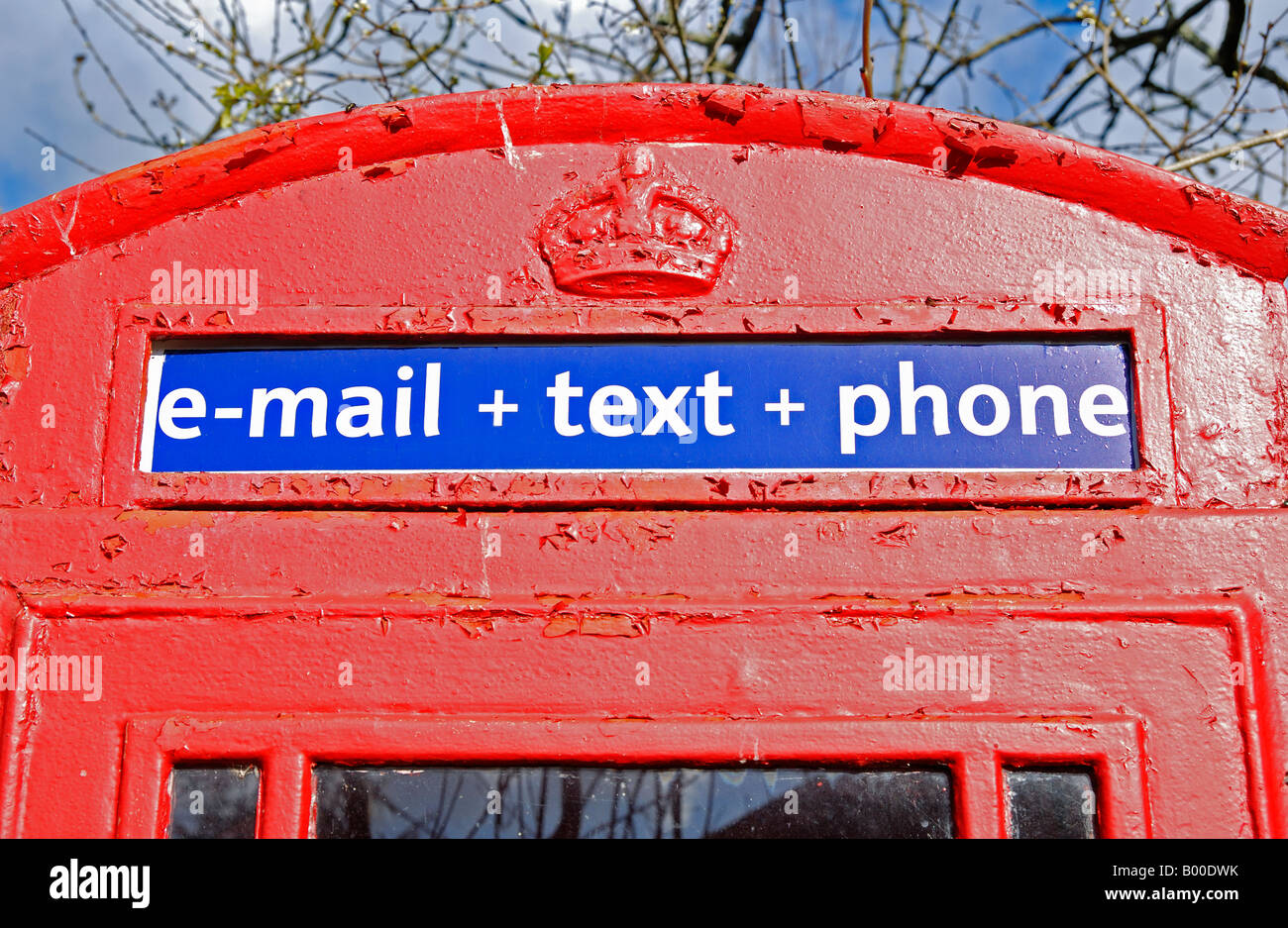 an english phone box showing text and e-mail information - Stock Image