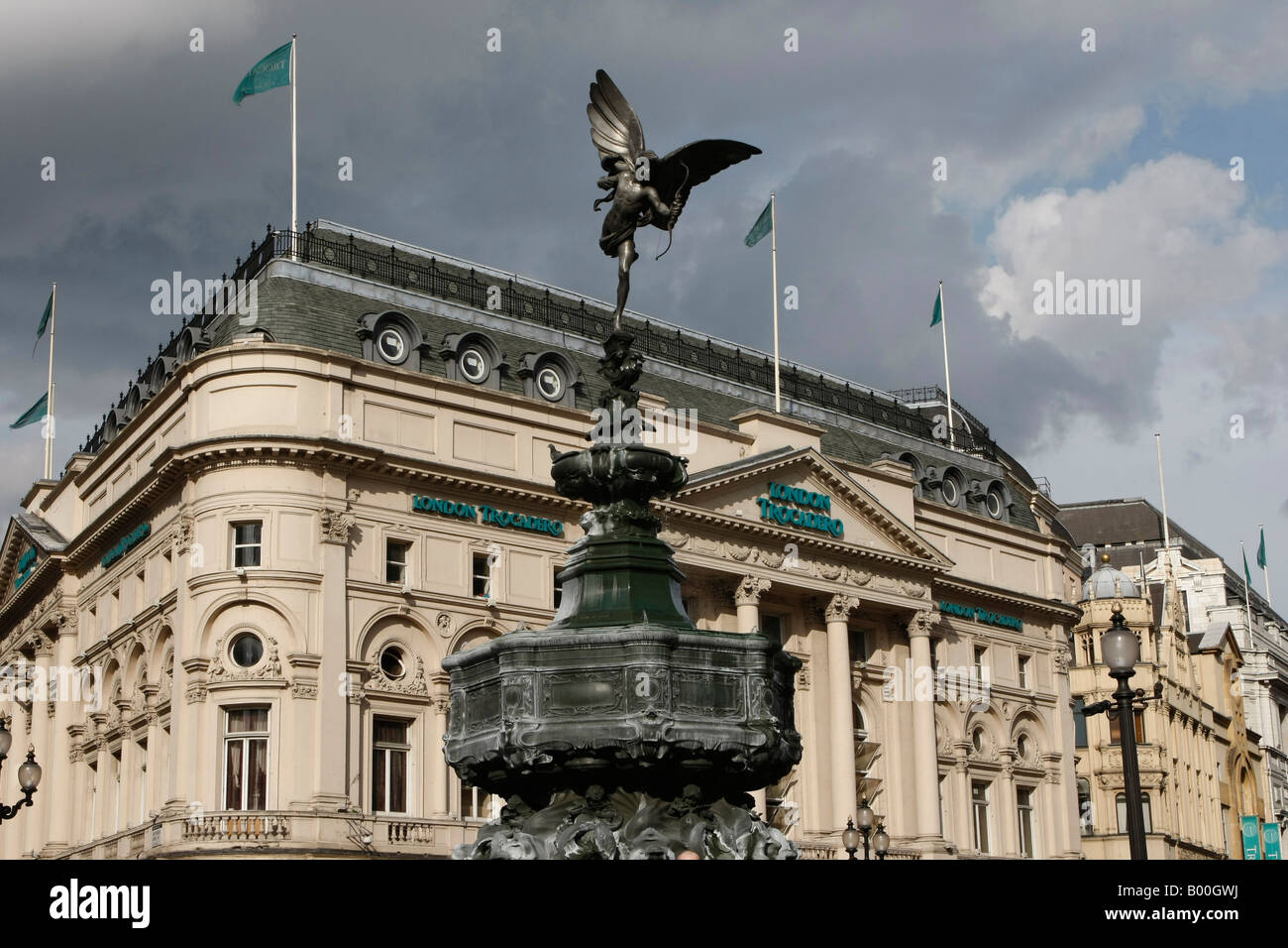 Eros statue in Piccadilly Circus London with the famous TROCADERO CENTRE in background - Stock Image