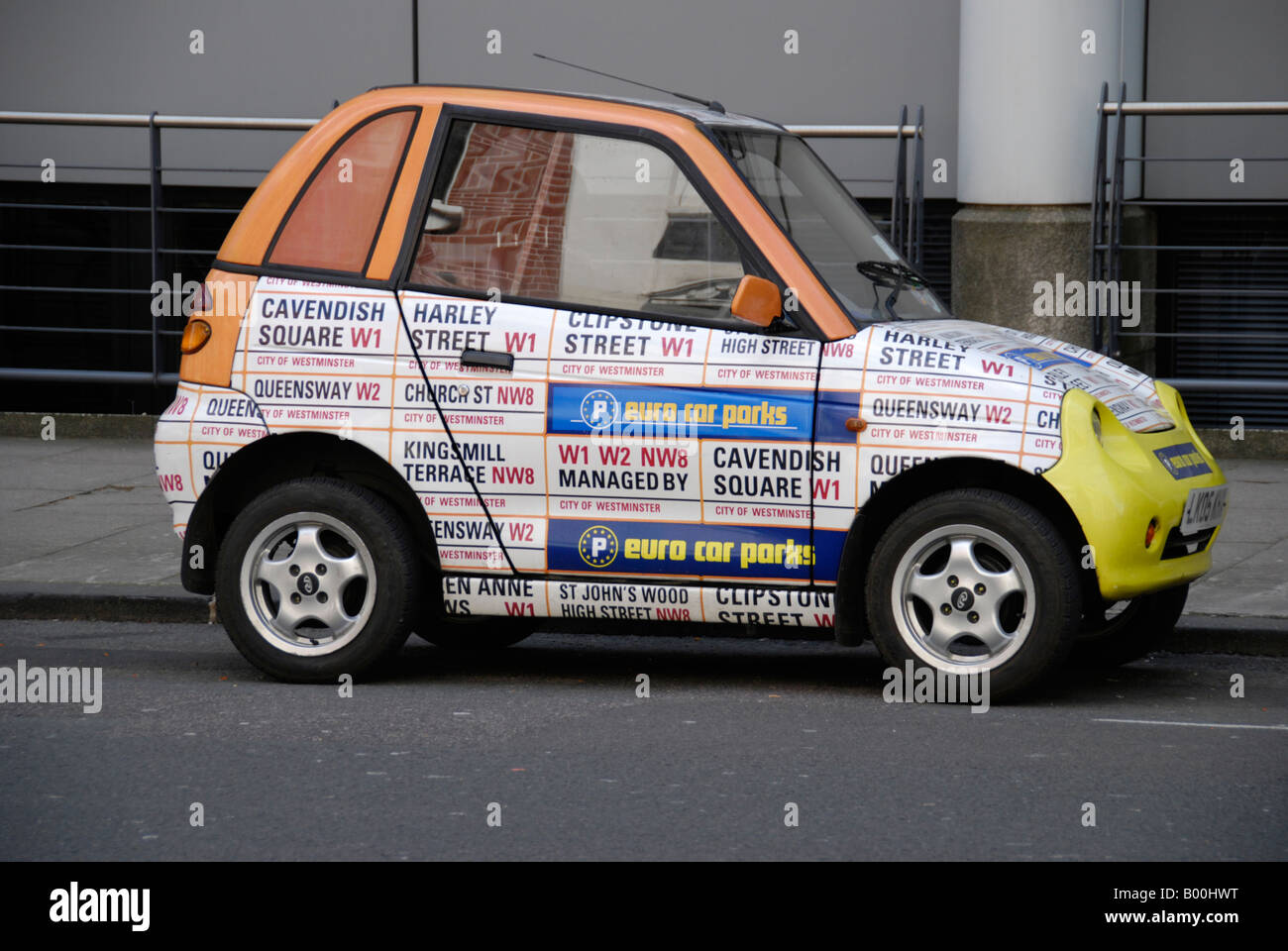 Small Car Covered In Advertisement In The Form Of London Street